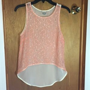 Pink and cream-colored sheer lace top.